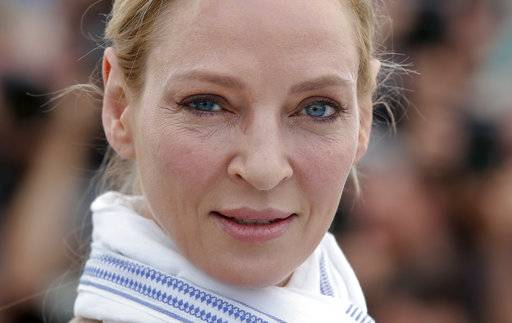 FILE - In this May 18, 2017 file photo, actress Uma Thurman poses for photographers during the photo call for the Un Certain Regard jury at the 70th international film festival, Cannes, southern France.  Thurman has accused embattled Hollywood producer Harvey Weinstein of forcing himself upon her sexually and director Quentin Tarantino of making her perform a dangerous car stunt that injured her. Thurman is quoted in The New York Times on Saturday, Feb. 3, 2018,  as saying Weinstein attacked her in London. She says he pushed her down and tried to shove himself on her and expose himself.
