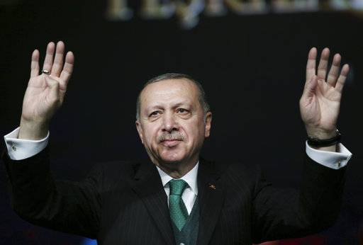 Turkey's President Recep Tayyip Erdogan, gestures as he attends a national youth foundation event in Ankara, Turkey, Thursday, Feb. 1, 2018. Syrian government forces pushed into an opposition stronghold on Thursday, as Turkish troops and allied Syrian fighters battled with Kurdish militants in a nearby area. (Yasin Bulbul/Pool Photo via AP)