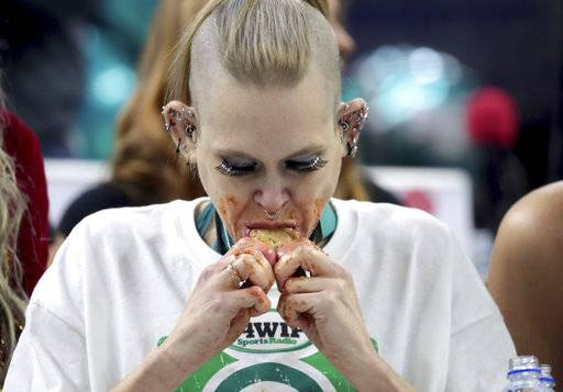 Molly Schuyler eats wings in the final round of WIP's Wing Bowl 26 at the Wells Fargo Center in Philadelphia, Friday, Feb. 2, 2018. Schuyler ate 501 wings.  Schuyler gnawed her way through a record 501 chicken wings in 30 minutes to win her third Wing Bowl in Philadelphia. Wing Bowl is usually Philadelphia's substitute for the Eagles going to the Super Bowl. But Friday's competition was an unusual two-fer. It was also a rally for the Eagles on the eve of their third Super Bowl appearance. (Tim Hawk/NJ Advance Media via AP)