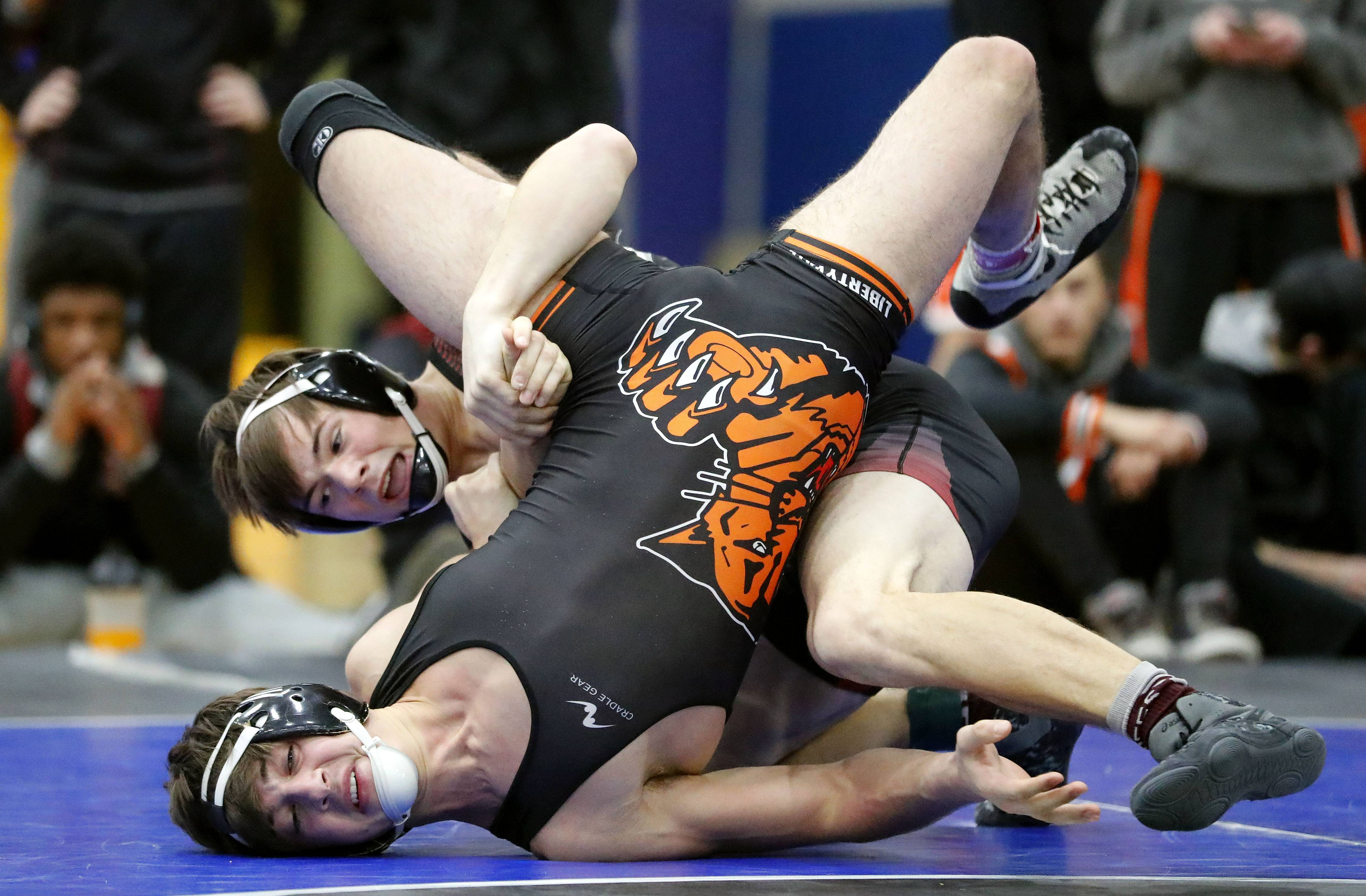 Libertyville's Niko Christensen, bottom, takes on Zion's Tyler Creamer in the 160-pound third-place match during the Class 3A Warren regional Saturday in Gurnee.