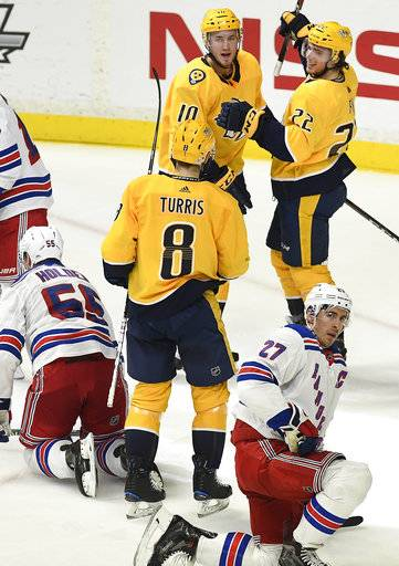 Nashville Predators left wing Kevin Fiala (22) is congratulated by center Colton Sissons (10) and center Kyle Turris (8) after scoring a goal against the New York Rangers in the third period of an NHL hockey game Saturday, Feb. 3, 2018, in Nashville, Tenn. (George Walker IV/The Tennessean via AP)