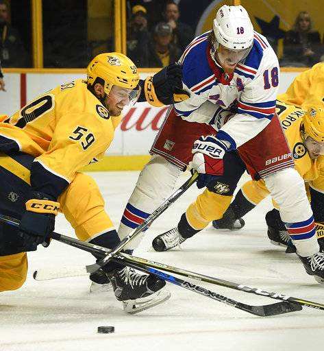 New York Rangers defenseman Marc Staal (18) tries to shoot the puck past Nashville Predators defenseman Roman Josi (59) in the first period of an NHL hockey game Saturday, Feb. 3, 2018, in Nashville, Tenn. (George Walker IV/The Tennessean via AP)
