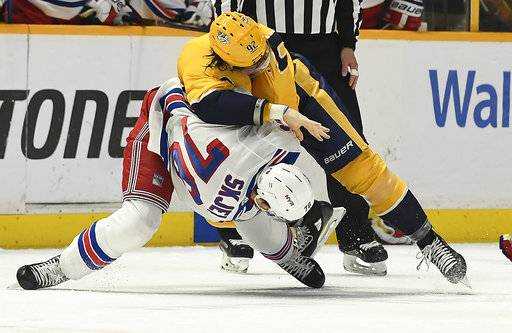 Nashville Predators center Ryan Johansen (92) slams New York Rangers defenseman Brady Skjei (76) to the ice as they fight in the second period of an NHL hockey game Saturday, Feb. 3, 2018, in Nashville, Tenn. (George Walker IV/The Tennessean via AP)