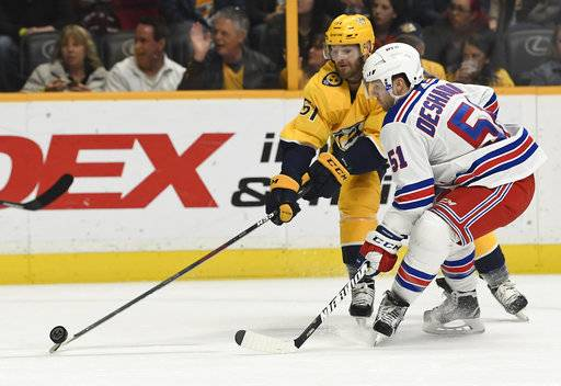 Nashville Predators left wing Austin Watson (51) shoots the puck past New York Rangers center David Desharnais (51) in the second period of an NHL hockey game Saturday, Feb. 3, 2018, in Nashville, Tenn. (George Walker IV/The Tennessean via AP)
