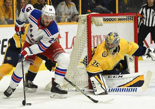 New York Rangers center Paul Carey (28) tries to get the puck past Nashville Predators goaltender Pekka Rinne (35) in the first period of an NHL hockey game Saturday, Feb. 3, 2018, in Nashville, Tenn. (George Walker IV/The Tennessean via AP)