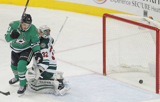 Dallas Stars forward Mattias Janmark (13) celebrates tipping a shot past Minnesota Wild goaltender Alex Stalock (32) during the second period of an NHL hockey game Saturday, Feb. 3, 2018, in Dallas.
