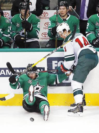 Dallas Stars forward Alexander Radulov (47) and Minnesota Wild forward Joel Eriksson Ek (14) battle for the puck during the first period of an NHL hockey game Saturday, February 3, 2018, in Dallas.
