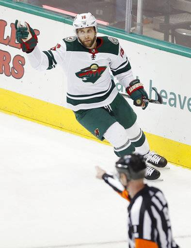 Minnesota Wild forward Jason Zucker (16) celebrates scoring a goal during the third period of an NHL hockey game against the Dallas Stars on Saturday, Feb. 3, 2018, in Dallas. Dallas won 6-1.