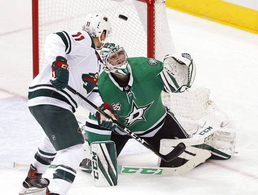 Minnesota Wild forward Zach Parise (11) looks for the rebound off of Dallas Stars goaltender Kari Lehtonen (32) during the first period of an NHL hockey game Saturday, Feb. 3, 2018, in Dallas.