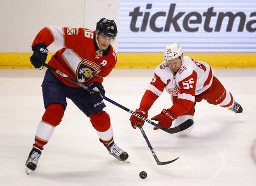 Florida Panthers center Aleksander Barkov (16) and Detroit Red Wings defenseman Niklas Kronwall (55) battle for the puck during the second period of an NHL hockey game, Saturday, Feb. 3, 2018 in Sunrise, Fla.