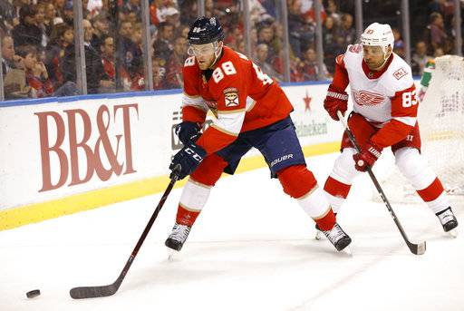 Florida Panthers left wing Jamie McGinn (88) and Detroit Red Wings defenseman Trevor Daley (83) battle for the puck during the first period of an NHL hockey game, Saturday, Feb. 3, 2018 in Sunrise, Fla.