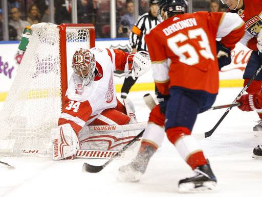 Florida Panthers right wing Evgenii Dadonov (63) attempts a shot at Detroit Red Wings goaltender Petr Mrazek (34) during the first period of an NHL hockey game, Saturday, Feb. 3, 2018 in Sunrise, Fla.
