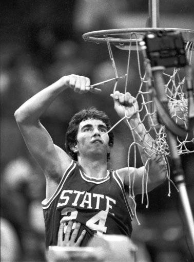 This 1983 photo shows North Carolina State's Terry Gannon helping cut down the nets following the Wolfpack's ACC Tournament Championship game in Atlanta, Ga. Gannon doesn't fit the profile. Sure, he's dunked plenty, and hit some long-range jumpers. But he certainly hasn't landed a quad or attempted a camel spin. An NCAA basketball champion at North Carolina State and a professional sportscaster handling hoops and golf, somehow Gannon has become the lead play-by-play voice of figure skating.  (Robert Willett/The News & Observer via AP)