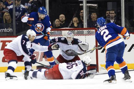New York Islanders defenseman Nick Leddy (2) scores a goal past Columbus Blue Jackets goaltender Joonas Korpisalo (70) during the first period of an NHL hockey game, Saturday, Feb. 3, 2018 in New York.