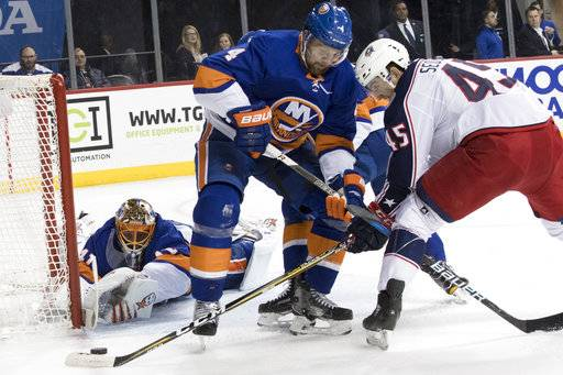 New York Islanders goaltender Jaroslav Halak (41) makes a saves against Columbus Blue Jackets center Lukas Sedlak (45) during the first period of an NHL hockey game, Saturday, Feb. 3, 2018 in New York.