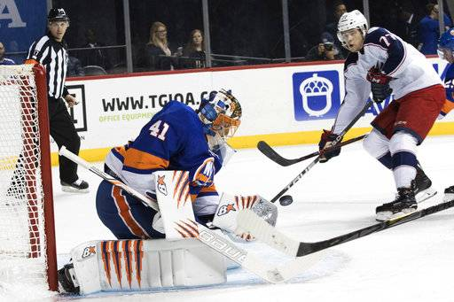 New York Islanders goaltender Jaroslav Halak (41) blocks a shot by Columbus Blue Jackets right wing Josh Anderson (77) during the first period of an NHL hockey game, Saturday, Feb. 3, 2018 in New York.