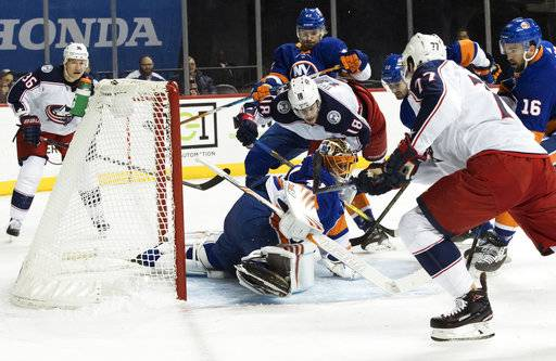 Columbus Blue Jackets right wing Josh Anderson (77) scores a goal past New York Islanders goaltender Jaroslav Halak (41) during the first period of an NHL hockey game, Saturday, Feb. 3, 2018 in New York.