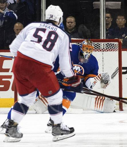 New York Islanders goaltender Jaroslav Halak makes a glove save against a shot at goal by Columbus Blue Jackets defenseman David Savard (58) during the second period of an NHL hockey game, Saturday, Feb. 3, 2018 in New York.