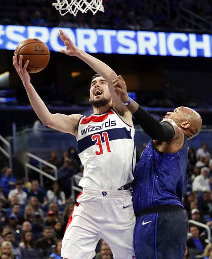 Washington Wizards' Tomas Satoransky (31) gets around Orlando Magic's Marreese Speights, right, for a shot during the first half of an NBA basketball game Saturday, Feb. 3, 2018, in Orlando, Fla.