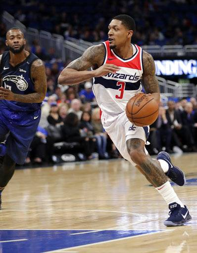 Washington Wizards' Bradley Beal (3) drives to the basket past Orlando Magic's Jonathon Simmons during the first half of an NBA basketball game Saturday, Feb. 3, 2018, in Orlando, Fla.