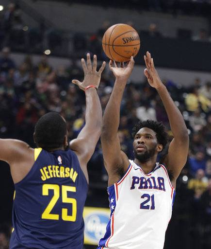 Philadelphia 76ers' Joel Embiid, right, shoots over Indiana Pacers' Al Jefferson during the first half of an NBA basketball game, Saturday, Feb. 3, 2018, in Indianapolis.