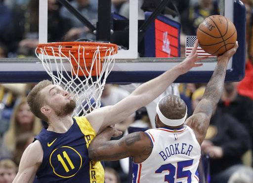 Indiana Pacers' Domantas Sabonis (11) blocks the shot of Philadelphia 76ers' Trevor Booker during the second half of an NBA basketball game, Saturday, Feb. 3, 2018, in Indianapolis.