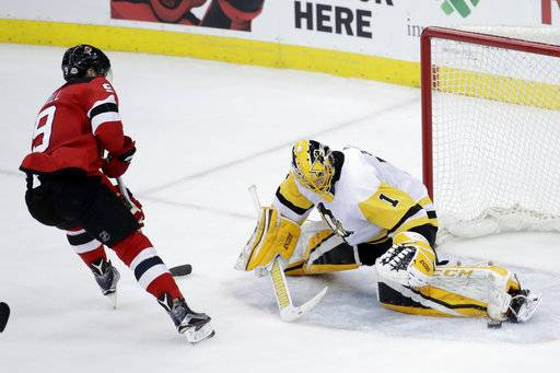 Pittsburgh Penguins goaltender Casey DeSmith (1) blocks a shot by New Jersey Devils left wing Taylor Hall (9) during the third period of an NHL hockey game Saturday, Feb. 3, 2018, in Newark, N.J. The Devils won 3-1.