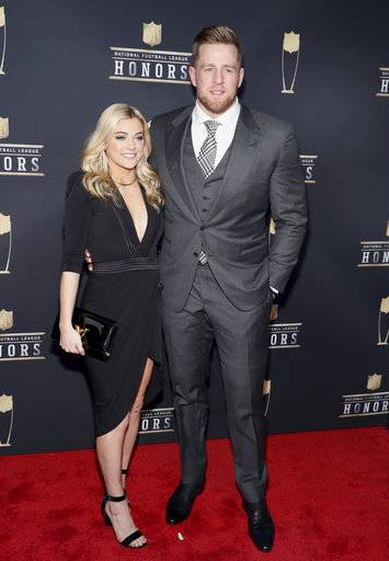 In this photo provided by the NFL, J. J. Watt of the Huston Texans, right, and Kealia Ohai arrives at the 7th Annual NFL Honors at the Cyrus Northrop Memorial Auditorium on Saturday, Feb. 3, 2018, in Minneapolis, Minnesota. (Photo by Michael Zorn/Invision for NFL/AP Images)