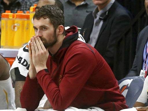 FILE - In this Jan. 8, 2018, file photo, Cleveland Cavaliers' Kevin Love watches from the bench in the second half of an NBA basketball game against the Minnesota Timberwolves in Minneapolis. Love will miss two months with a broken left hand, but he does not need surgery. Love broke the fifth metacarpal Tuesday, Jan. 30, in the first quarter of a loss at Detroit.
