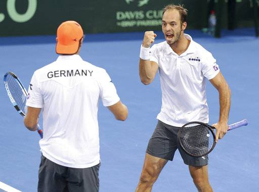 Tim Puetz of Germany, right, reacts with his team mate Jan-Lennard Struff ,left, after winning a point in the doubles match between Germany and Australia at the Davis Cup World Group first round in Brisbane, Australia, Saturday, Feb.3, 2018.