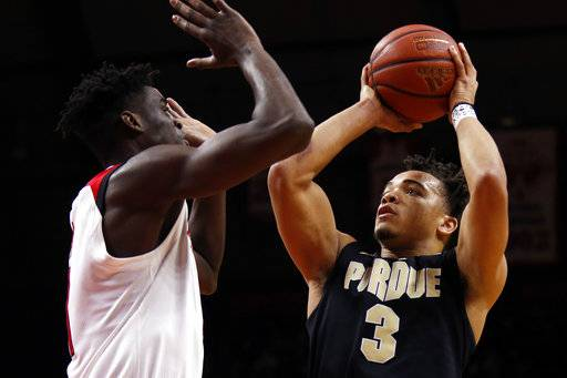 Purdue guard Carsen Edwards (3) shoots over Rutgers forward Mamadou Doucoure during the first half of an NCAA college basketball game Saturday, Feb. 3, 2018, in Piscataway, N.J.