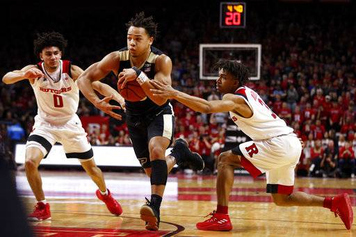 Purdue guard Carsen Edwards, center, drives to the basket between Rutgers guard Corey Sanders (3) and guard Geo Baker (0) during the first half of an NCAA college basketball game Saturday, Feb. 3, 2018, in Piscataway, N.J.