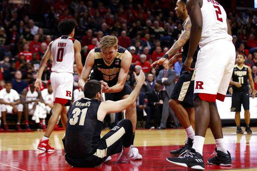 Purdue forward Matt Haarms (32) congratulates and helps up Dakota Mathias (31) after Mathias took a foul against Rutgers during the second half of an NCAA college basketball game Saturday, Feb. 3, 2018, in Piscataway, N.J.