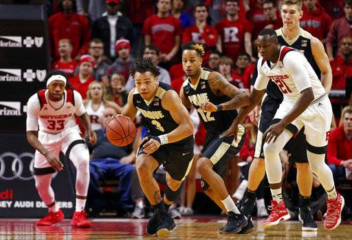Purdue guard Carsen Edwards (3) brings the ball upcourt after stealing it from Rutgers forward Deshawn Freeman (33) during the first half of an NCAA college basketball game Saturday, Feb. 3, 2018, in Piscataway, N.J.