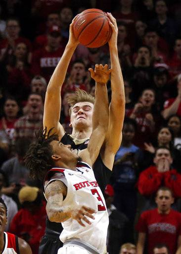 Purdue forward Matt Haarms, top, grabs a rebound over Rutgers guard Corey Sanders (3) during the second half of an NCAA college basketball game Saturday, Feb. 3, 2018, in Piscataway, N.J.