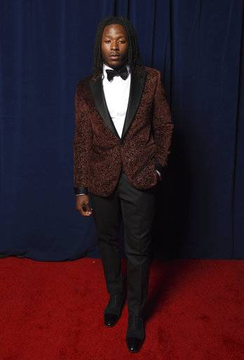 In this photo provided by the NFL, Alvin Kamara of the New Orleans Saints poses backstage at the 7th Annual NFL Honors at the Cyrus Northrop Memorial Auditorium on Saturday, Feb. 3, 2018, in Minneapolis. (Peter Barreras/NFL via AP)