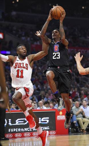 Los Angeles Clippers guard Lou Williams, right, shoots as Chicago Bulls guard David Nwaba defends during the first half of an NBA basketball game, Saturday, Feb. 3, 2018, in Los Angeles.