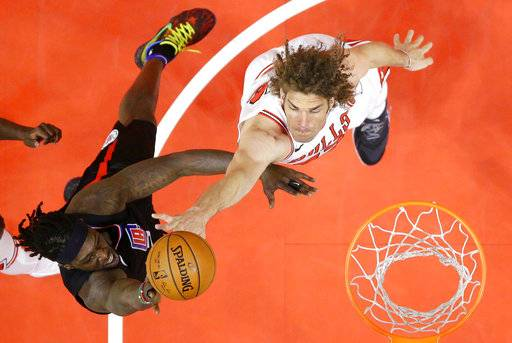 Los Angeles Clippers forward Montrezl Harrell, left, shoots as Chicago Bulls center Robin Lopez defends during the first half of an NBA basketball game, Saturday, Feb. 3, 2018, in Los Angeles.