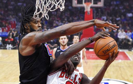 Los Angeles Clippers center DeAndre Jordan, left, blocks the shot of Chicago Bulls guard Jerian Grant during the first half of an NBA basketball game, Saturday, Feb. 3, 2018, in Los Angeles.