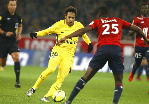 PSG's Neymar Jr controls the ball during his French League One soccer match between Paris Saint Germain and Lille at the Lille Metropole stadium, in Villeneuve d'Ascq, northern France, Saturday, Feb. 3, 2018.