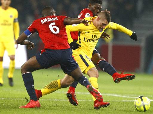 PSG's Marco Verratti, right, controls the ball during the French League One soccer match between Paris Saint Germain and Lille at the Lille Metropole stadium, in Villeneuve d'Ascq, northern France, Saturday, Feb. 3, 2018.