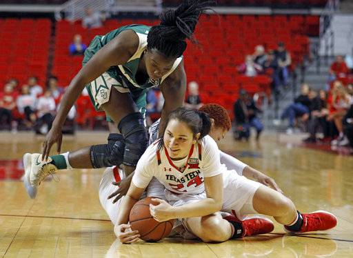 Texas Tech's Haley Bruedigam (24) and Baylor's Dekeiya Cohen (1) dive for a loose ball during the first half of an NCAA college basketball game Saturday, Feb. 3, 2018, in Lubbock, Texas.