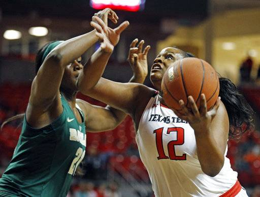 Texas Tech's Jada Terry (21) shoots the ball around Baylor's Kalani Brown (12) during the first half of an NCAA college basketball game Saturday, Feb. 3, 2018, in Lubbock, Texas.
