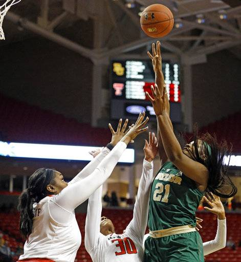 Baylor's Kalani Brown (21) shoots the ball over Texas Tech's Erin Degrate (1) during the first half of an NCAA college basketball game Saturday, Feb. 3, 2018, in Lubbock, Texas.