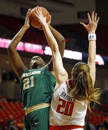 Baylor's Kalani Brown (21) shoots the ball over Texas Tech's Brittany Brewer (20) during the first half of an NCAA college basketball game Saturday, Feb. 3, 2018, in Lubbock, Texas.