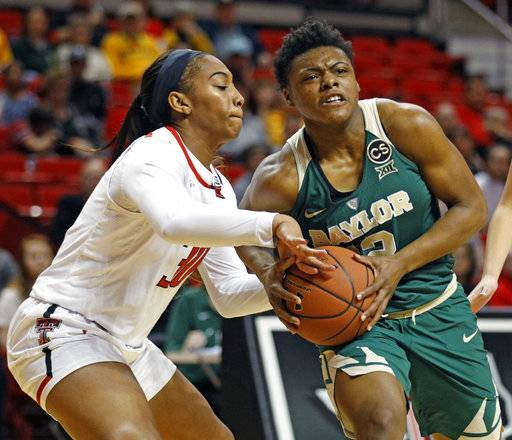 Texas Tech's Zuri Sanders (30) tries to steal the ball from Baylor's Moon Ursin (12) during the second half of an NCAA college basketball game Saturday, Feb. 3, 2018, in Lubbock, Texas.