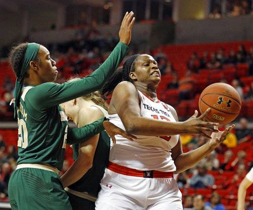 Texas Tech's Jada Terry (12) tries to rebound the ball during the second half of an NCAA college basketball game against Baylor, Saturday, Feb. 3, 2018, in Lubbock, Texas.