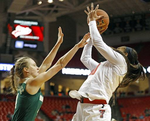 Texas Tech's Zuri Sanders (30) shoots the ball over Baylor's Kristy Wallace (4) during the first half of an NCAA college basketball game Saturday, Feb. 3, 2018, in Lubbock, Texas.