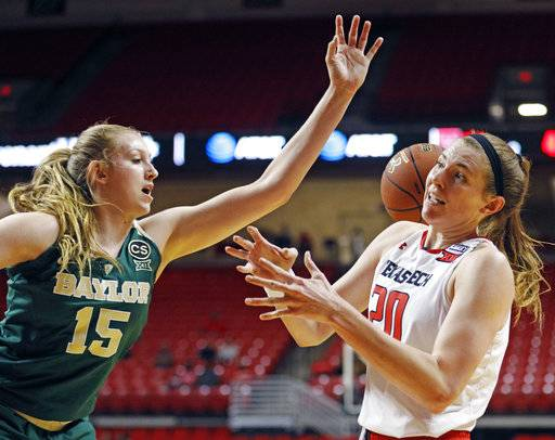 Baylor's Lauren Cox (15) knocks the ball away from Texas Tech's Brittany Brewer (20) during the first half of an NCAA college basketball game Saturday, Feb. 3, 2018, in Lubbock, Texas.