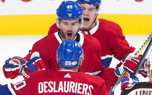 Montreal Canadiens' Logan Shaw (49) celebrates with Nicolas Deslauriers (20) after scoring against the Anaheim Ducks during the first period of an NHL hockey game in Montreal, Saturday, Feb. 3, 2018. (Graham Hughes/The Canadian Press via AP)
